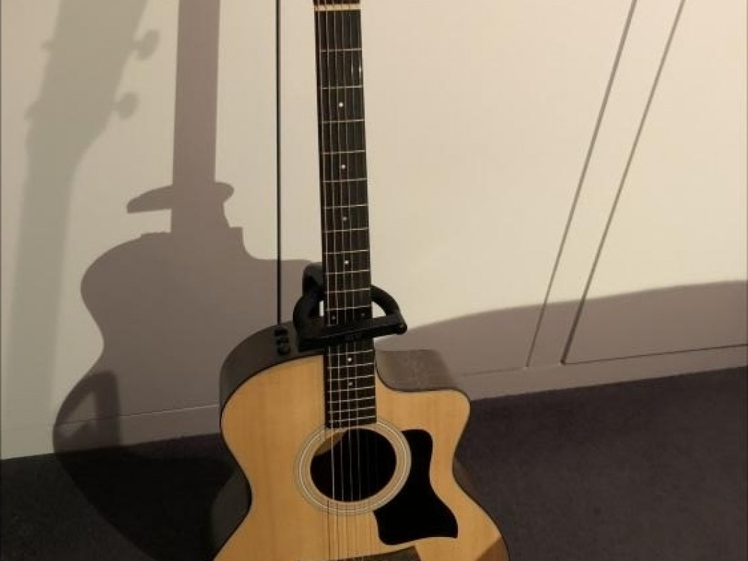 Taylor electric acoustic guitar