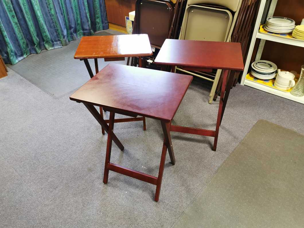 Three folding occasional tables