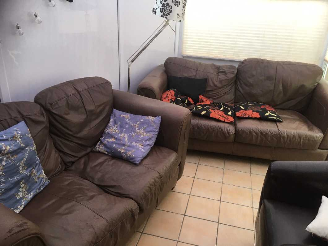Two Brown Leather Sofas Free to take away