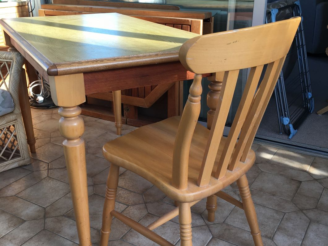 Wooden Kitchen table 45' x 25' and 4 chairs