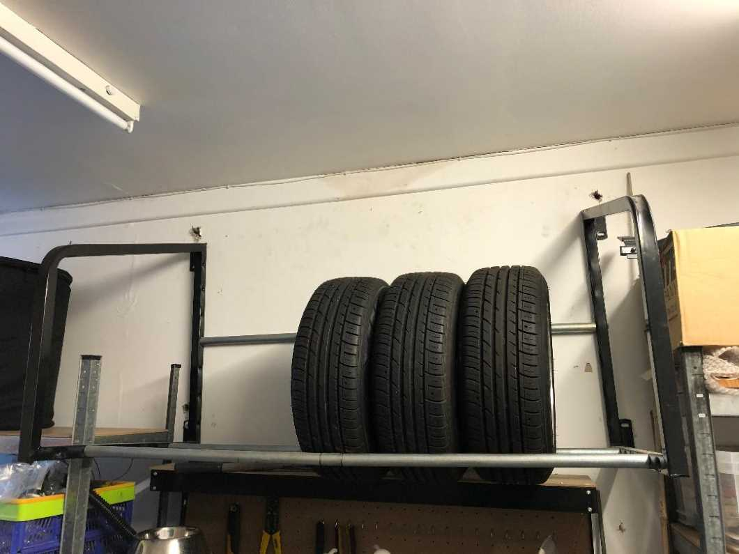 Wall-mounted wheel and tyre racks - one new and one used