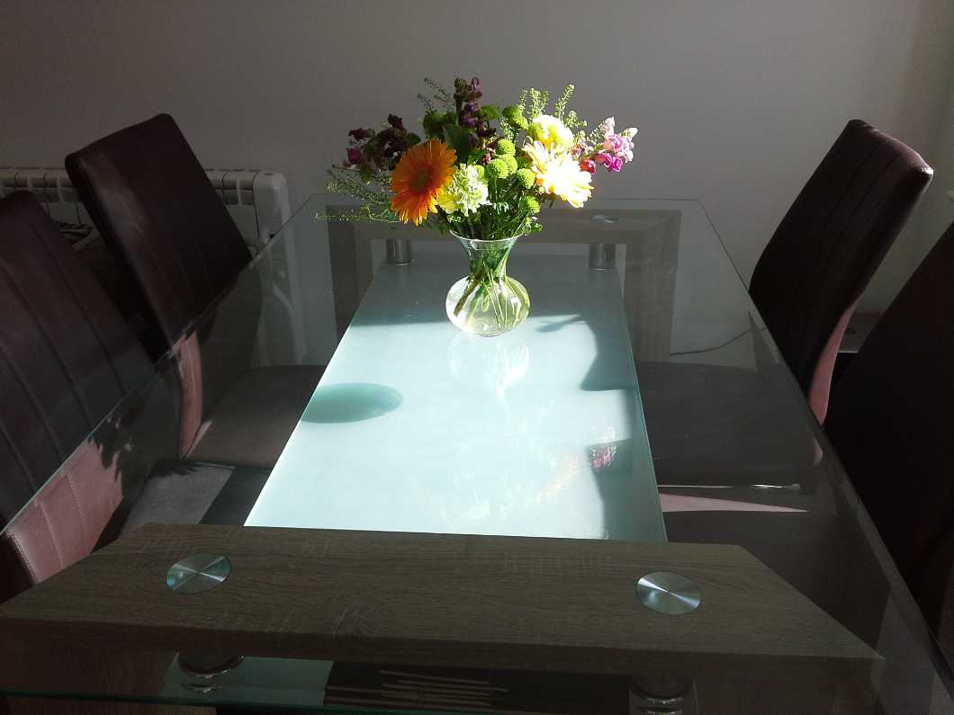Glass table and 4 chairs.