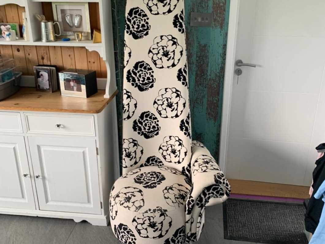 Black and white high back single arm feature chair
